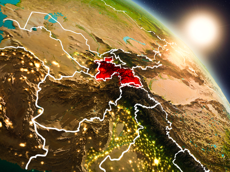 Sunset above Tajikistan from space on planet Earth with visible country borders. 3D illustration.