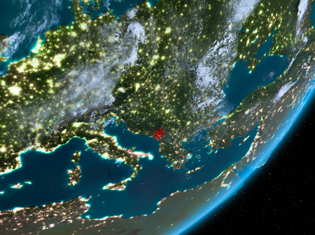 Montenegro from orbit of planet Earth at night with highly detailed surface textures and clouds. 3D illustration. Stock Photo