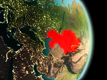 Early morning view of Kazakhstan highlighted in red on planet Earth. 3D illustration. Stock Photo