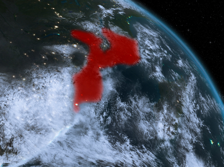 Night above Mozambique highlighted in red on model of planet Earth in space. 3D illustration.