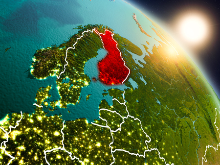 Sunset above Finland from space on planet Earth with visible country borders. 3D illustration. 写真素材