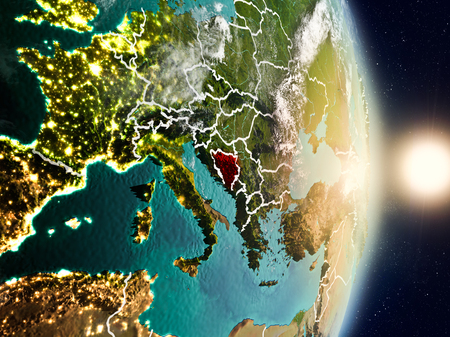 Bosnië-Herzegovina tijdens zonsopgang in rood op planeetaarde met zichtbare landgrenzen die wordt benadrukt. 3D illustratie.