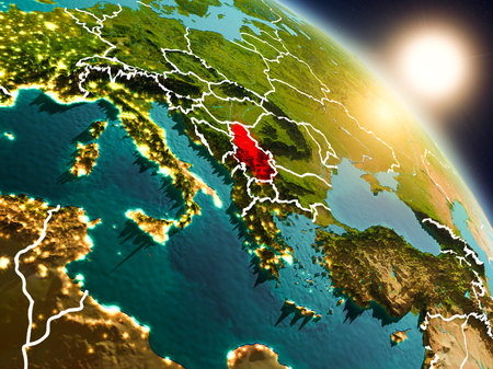 Sunset above Serbia from space on planet Earth with visible country borders. 3D illustration. Фото со стока