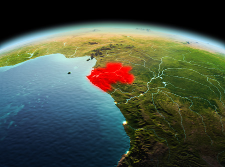 Morning above Gabon highlighted in red on model of planet Earth in space. 3D illustration.