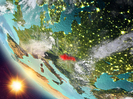 Slovakia during sunset highlighted in red on planet Earth with clouds. 3D illustration. Elements of this image furnished by NASA. Stock Photo