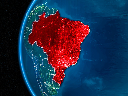 Space orbit view of Brazil highlighted in red on planet Earth at night with visible country borders and city lights.