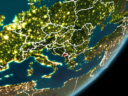 Montenegro as seen from Earth's orbit on planet Earth at night highlighted in red with visible borders and city lights.