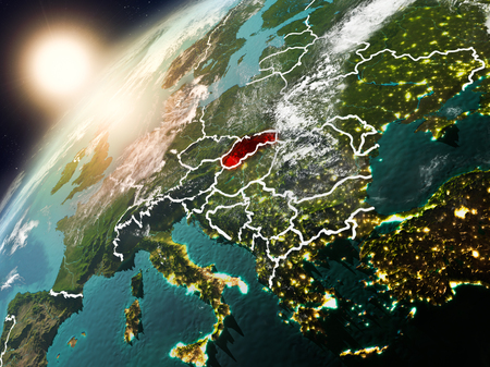 Slovakia during sunset highlighted in red on planet Earth with clouds and visible country borders. 3D illustration.