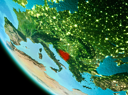 Country of Bosnia and Herzegovina in red on planet Earth in the evening. 3D illustration.