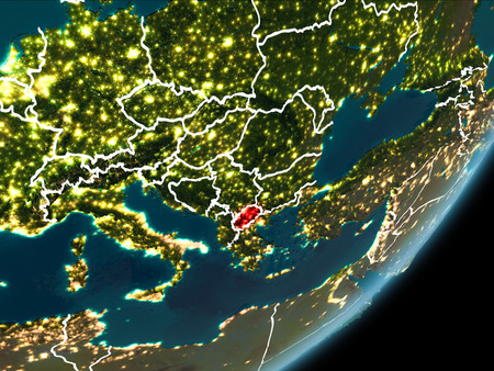 Macedonia as seen from Earth's orbit on planet Earth at night highlighted in red with visible borders and city lights. 3D illustration.