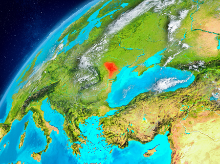 Country of Moldova in red on planet Earth with atmosphere. 3D illustration. Stock Photo