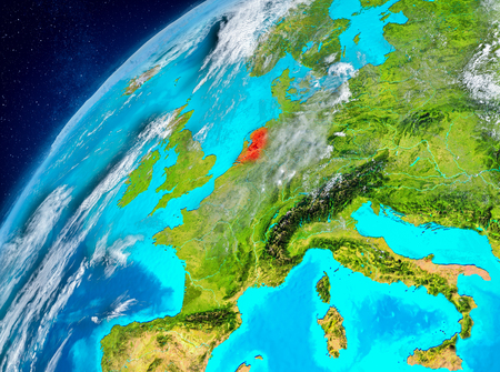 Country of Netherlands in red on planet Earth with atmosphere. 3D illustration.