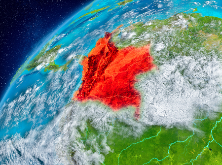 Country of Colombia in red on planet Earth with atmosphere. 3D illustration. Stock Photo