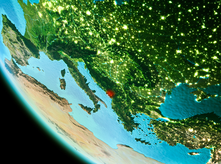 Country of Montenegro in red on planet Earth in the evening. 3D illustration. Stock Photo