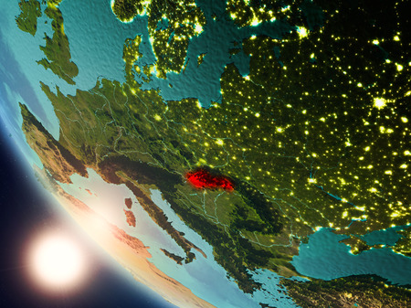 Satellite view of Slovakia highlighted in red on planet Earth with visible country borders during sunset. 3D illustration.