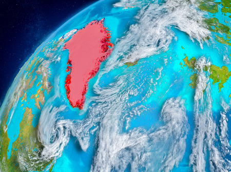 Country of Greenland in red on planet Earth with atmosphere. 3D illustration.