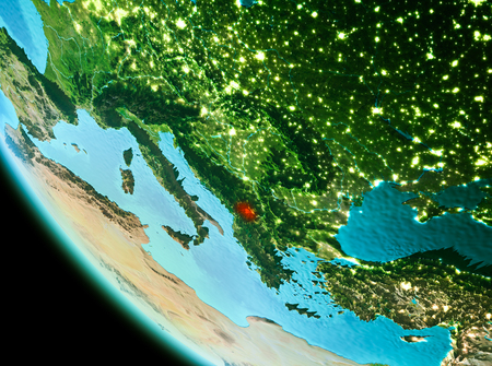Country of Kosovo in red on planet Earth in the evening. 3D illustration. Stock Photo