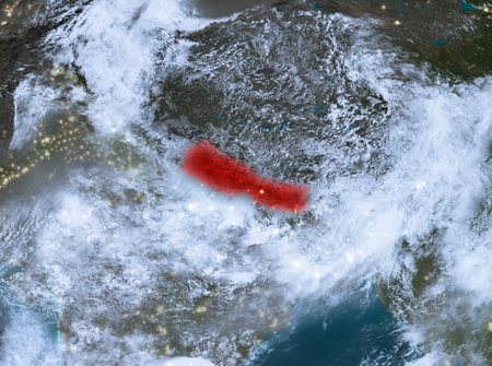 Country of Nepal in red on planet Earth with clouds at night. 3D illustration. Elements of this image furnished by NASA.
