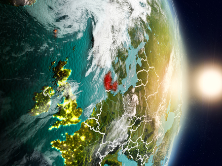 Denmark during sunrise highlighted in red on planet Earth with visible country borders. 3D illustration