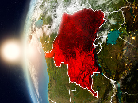 Satellite view of Democratic Republic of Congo highlighted in red on planet Earth with clouds and visible country borders during sunset. 3D illustration.
