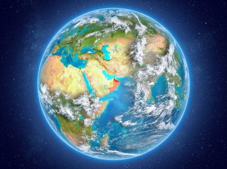 Oman in red on model of planet Earth with clouds and atmosphere in space. 3D illustration.