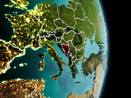 Satellite morning view of Bosnia and Herzegovina highlighted in red on planet Earth with visible border lines and city lights. 3D illustration.