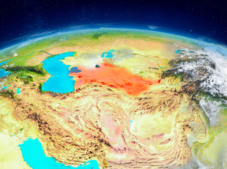 Orbit view of Turkmenistan highlighted in red on planet Earth with highly detailed surface textures. 3D illustration.