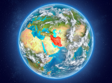 Iran in red on model of planet Earth with clouds and atmosphere in space. 3D illustration.