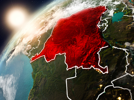 Democratic Republic of Congo during sunset highlighted in red on planet Earth with clouds and visible country borders. 3D illustration. Stock Photo
