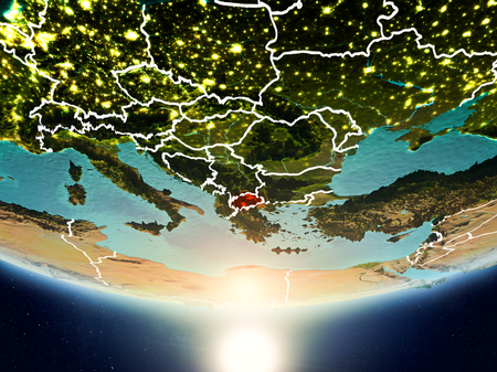 Macedonia from orbit of planet Earth in sunrise with highly detailed surface textures and visible country borders. 3D illustration.