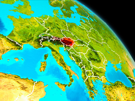 Space orbit view of Austria highlighted in red on planet Earth with visible borders. 3D illustration.