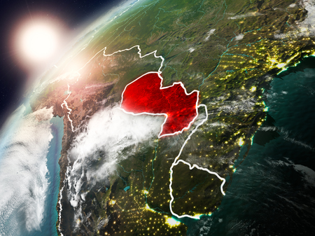 Paraguay during sunset highlighted in red on planet Earth with clouds and visible country borders. 3D illustration.