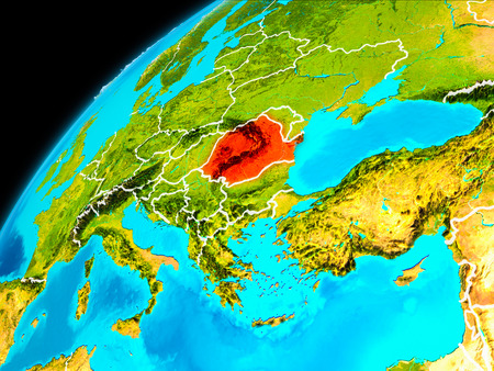 Orbit view of Romania highlighted in red with visible borderlines on planet Earth. 3D illustration. Stock Photo