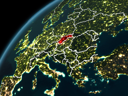 Slovakia in red on planet Earth at night with visible borderlines and city lights. 3D illustration.