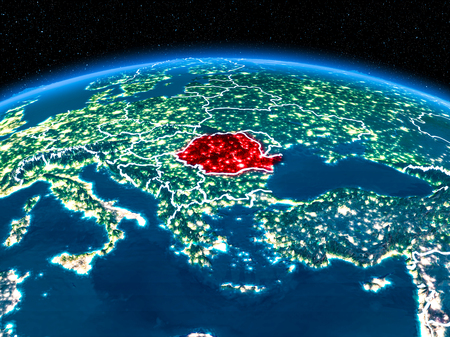 Orbit view of Romania highlighted in red with visible borderlines and city lights on planet Earth at night. 3D illustration.