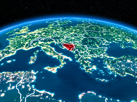 Orbit view of Bosnia and Herzegovina highlighted in red with visible borderlines and city lights on planet Earth at night. 3D illustration.