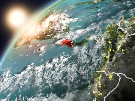 Costa Rica during sunset highlighted in red on planet Earth with clouds and visible country borders. 3D illustration. Stock Photo