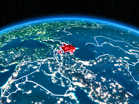 Orbit view of Azerbaijan highlighted in red with visible borderlines and city lights on planet Earth at night. 3D illustration.