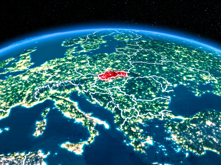 Orbit view of Slovakia highlighted in red with visible borderlines and city lights on planet Earth at night. 3D illustration.