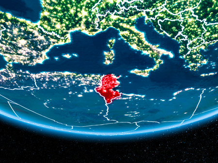 Tunisia in red with visible country borders and city lights from space at night. 3D illustration. Stock Photo