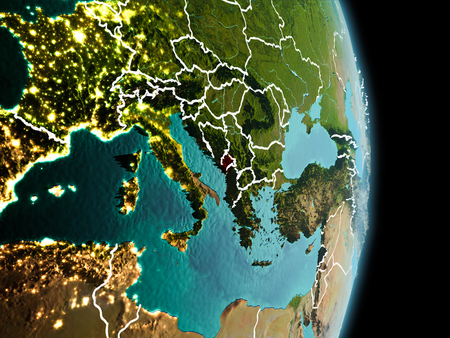 Satellite morning view of Montenegro highlighted in red on planet Earth with visible border lines and city lights. 3D illustration.