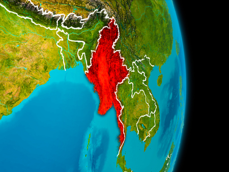 Myanmar in red on planet Earth with visible borderlines. 3D illustration. Imagens