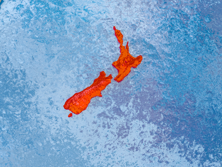 New Zealand in red on realistic map with embossed countries. 3D illustration. Elements of this image furnished by NASA.