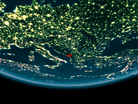 Montenegro at night highlighted in red on planet Earth. 3D illustration. Stock Photo
