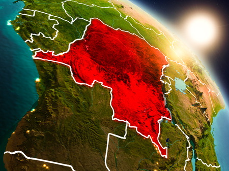 Sunset above Democratic Republic of Congo from space on planet Earth with visible country borders. 3D illustration.