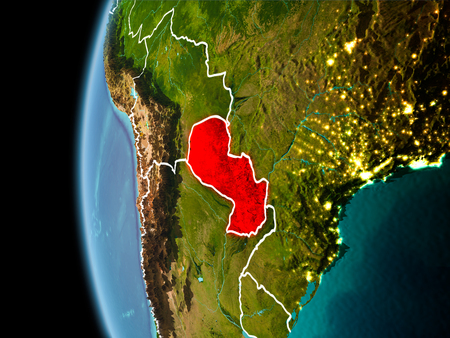 Evening over Paraguay as seen from space on planet Earth with visible border lines and city lights. 3D illustration. Stock Photo