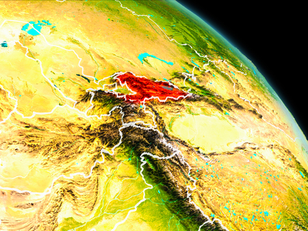 Space orbit view of Kyrgyzstan highlighted in red on planet Earth with visible borders. 3D illustration. Stock Photo