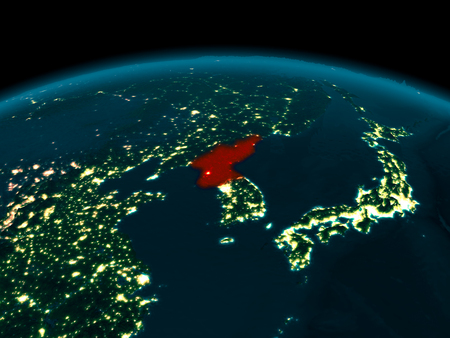 Country of North Korea in red on planet Earth at night. 3D illustration. Stock Photo