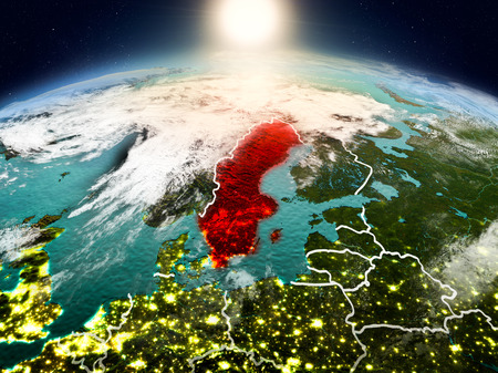 Sunrise above Sweden highlighted in red on model of planet Earth in space with visible country borders. 3D illustration. Stock Photo