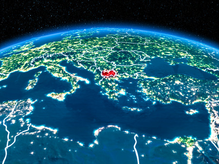 Orbit view of Macedonia highlighted in red with visible borderlines and city lights on planet Earth at night. 3D illustration